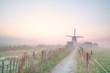 Dutch windmill in morning mist