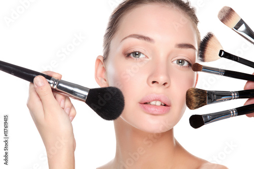 Poster Young woman with make up brush