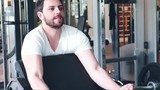 Young man in the gym, exercise for the biceps