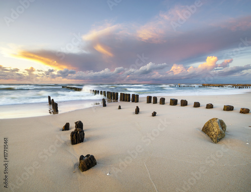 dynamic landscape of sea, the waves breaking on the breakwater, sunset on the sea beach