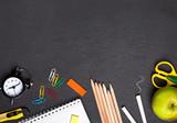 School supplies on the blackboard