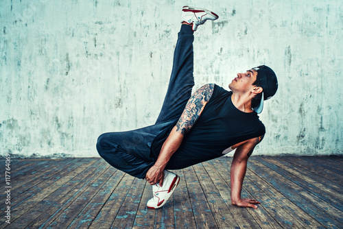 Naklejka Young man break dancing