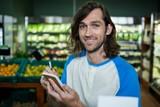 Man ticking on shopping checklist