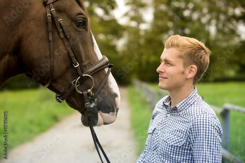 man and his horse at a farm