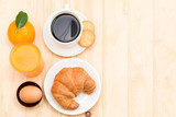 Delicious continental breakfast with fresh flaky croissants, assorted preserves, orange juice