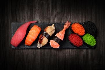 Sushi on black stone plate