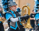 Teen baritone player marching in the band.  - 117866612