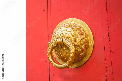 door handle made from golden metal on the red door Old Chinese style © rawintanpin