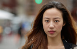 Young Asian woman in city serious face portrait - 117916011