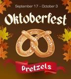 Oktoberfest vintage poster with Pretzels and autumn leaves on dark background. Octoberfest banner.
