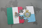 puzzle with the national flag of mexico and san marino on a world map background.