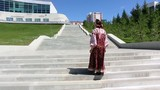 Girl in a national Sarafan climbs the stairs and dances