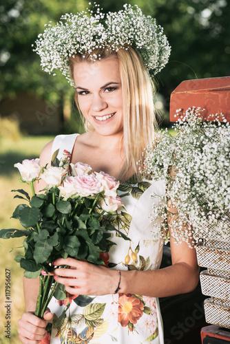Zdjęcia na płótnie, fototapety, obrazy : Beautiful farmer woman holding a bouquet of rose flower