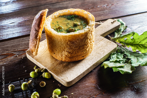 Poster soup served in a bread bowl