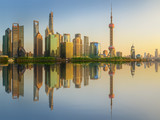 Cityscape of Shanghai and Huangpu River on sunset, beautiful reflection on skyscrapers, China