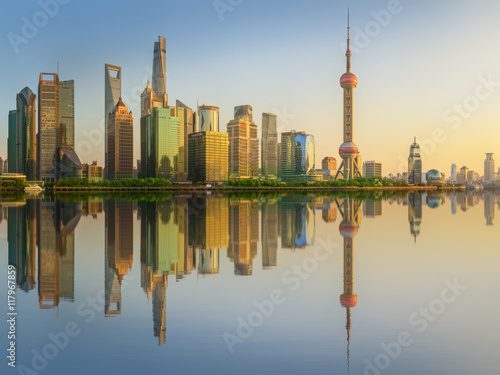 Poster Cityscape of Shanghai and Huangpu River on sunset, beautiful reflection on skysc