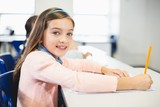 Schoolgirl smiling in classroom