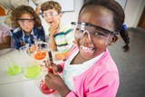 Fototapety Kids doing a chemical experiment in laboratory