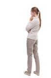 back view of standing young beautiful  woman.  girl  watching. Rear view people collection.  backside view of person.  Girl with long hair in a white jacket standing sideways resting his chin.