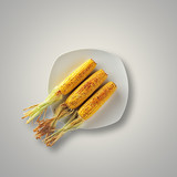 Whole Grilled Corn on a plate