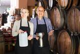 Portrait of two happy wine makers taking wine
