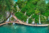 PLITVICE, CROATIA - JULY 29: Tourist enjoy sightseeing the lakes and wonderful landscapes at the Plitvice natural Park in Croatia during the summer holidays, on July 29th, 2016 in Plitvice, Croatia