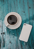 Cup of cofee and phone on tiffany wood background - 118055431