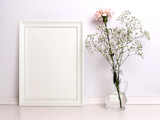 White frame mockup with flowers. Front viw of the empty white frame - Fine Art prints