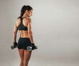 Rear three quarter view of beautiful bodybuilder