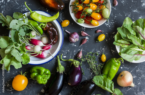Plakát Fresh vegetables - radishes, eggplant, pepper, tomatoes, onion, garlic on a dark wooden background