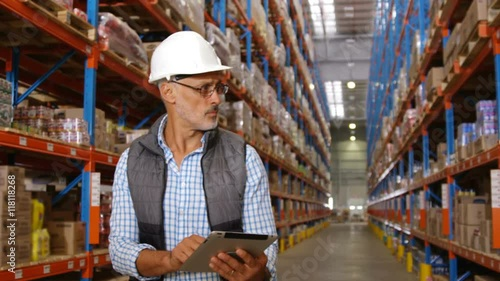 Staande foto Industrial geb. Warehouse worker using his tablet