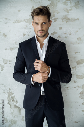 Plakat Portrait of sexy man in black suit