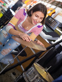 Young girl choosing drums and accessories