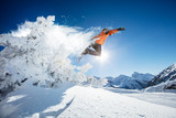 Snowboarder at jump in Alpine mountains