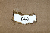 The word faq appearing behind torn paper