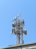 A big white antenna on blue sky