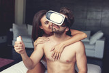 Sexy naked couple playing with VR headset