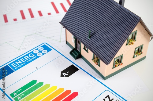 Energy efficiency concept with house model on desk Poster