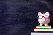 Piggybank with glasses and blackboard