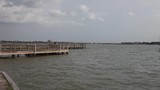 People fishing off dock at Clear Lake Park in Clear Lake City Texas.