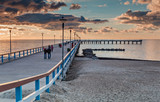 Colorful sunset at a famous marine pier in resort city of Palanga, Lithuania, Europe