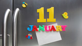 January 11 calendar date made with plastic magnetic letters holding a note of graph paper on door refrigerator
