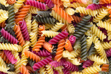 Closeup of raw eco macaroni pasta background.