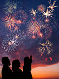 Happy family looks fireworks