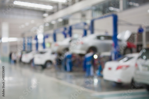 Fridge magnet car repair service center blurred background