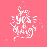 Say yes to things. Positive saying, brush lettering at pink grunge background