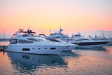 Extra Large Luxury yachts rest in the port at sunset - 118345889