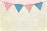Party flags hanging on colored cement wall background