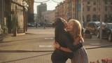Slow Mo Happy meeting of two friends hugging in the street