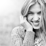 Outdoor portrait of beautiful smiling young woman - 118359615